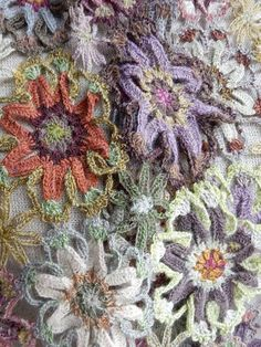 Boho chic flower child pattern hand crocheted of Merino wool. From Sophie Digard. 6 x 40 inches.