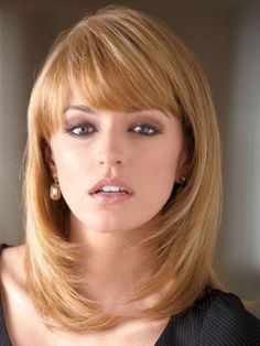Layered Medium Hairstyle With a Bang - the color is a little light for me but I like the style.