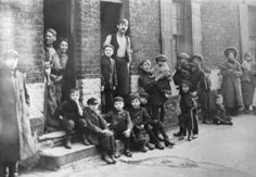 A group of boys and their families living in the East End of London c.1900