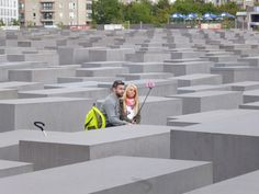 There are many people taking selfies at the Memorial to the Murdered Jews of Europe