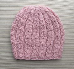 Knitting Pattern 162 Hat with Eyelet Braids for a LadyFind hundreds of fantastic hat knitting patterns!Knitting Hat Patterns and More by handknitsbyElenaThis beautiful hat is made in the round and does not have a seam. Baby Knitting Patterns, Baby Hats Knitting, Crochet Stitches Patterns, Crochet Baby Hats, Loom Knitting, Free Knitting, Knitted Hats, Knit Crochet, Tear