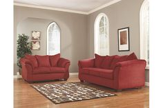 Talk about fine lines and great curves. That's the beauty of the Darcy sofa and loveseat set—made to suit your appreciation for clean, contemporary style. Striking flared profiles, comfy pillow top armrests and an ultra-soft upholstery that holds up to everyday living complete this fashion statement.