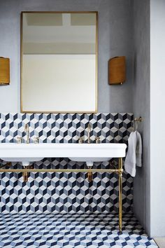 The geometric tiles create a sense of division and space, complemented by the brass taps and reclaimed wash stand. Bathroom Ideas (houseandgarden.co.uk)