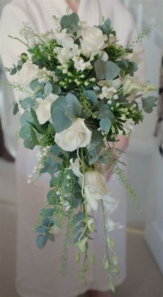 Don't like the teardrop shape but love the wildness and diff shades of green Trailing bouquet - Lily of the valley, eryngium, roses, dendrobium orchid & eucalyptus Orchid Bouquet Wedding, Cascading Wedding Bouquets, Bride Bouquets, Floral Wedding, Trailing Bouquet, Cascade Bouquet, Lily Of The Valley Bouquet, White Lily Bouquet, Lily Of The Valley Wedding Flowers
