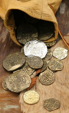 Writing Prompt: each coin was worth more than its weight because each one held magic. Whether for blessing or a curse, there was only one way to find out.