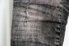 stitched-on patch, it appears, on torn jeans __  by Rosa Pomar, via Flickr