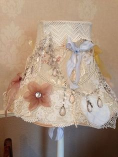 This is a lampshade ... but I'm picturing a simple cream bedspread with this adornment at the 2 corners at the foot of the bed