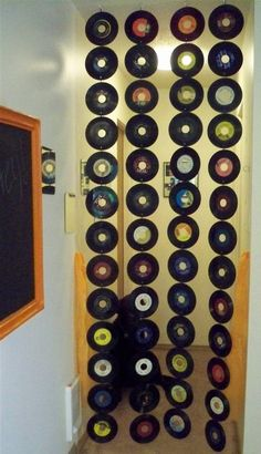 Small old records....make great wall hanging...  Or literally vinyl curtains    @Robin S. S. Scofield THis would be really tight too and I am sure we could find these somewhere. I know lubbock practically gives them away in our antique shops.. for the Coffee Nook