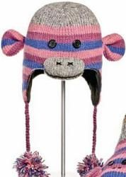 Youth/Adult Purple Striped Sock Monkey Pilot Hat by Knitwits - A1709P  Delux Knitwits are made of 100% natural wool from New Zealand. Wool contains lanolin which makes it water resistant and gives it a natural self cleaning effect. Knitwits are made in a fair trade environment with a portion of our proceeds donated to the community in which they were created. Sized for Youth/Adults.