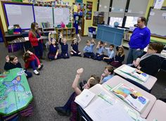 Third-grade students in Joe Palade's (standing, right) class at St. Mary School in Elgin take part in a weekly Friday Lord's Day Celebration, which is part of their Catholic Household Program. Principal Barbara Colandrea (seated, far right) watches students interact afterSophia May (standing, left) reads the next Sunday's Gospel. Read about Catholic School's Week in The Observer, Jan. 27, 2017.