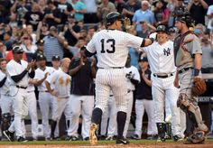 ALEX RODRIGUEZ THROUGH THE YEARS: -   Warm welcome -        New York Yankees' Alex Rodriguez celebrates with Mark Teixeira after hitting a home run, his 3,000th career hit, during the first inning June 19 against the Detroit Tigers in New York.  - © Bill Kostroun/AP