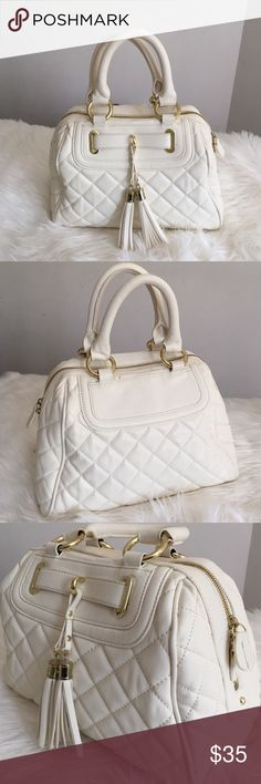 ‼️WeeKend Sale‼️•Steve Madden Tassel Bag• Ivory satchel bag/only carried a few times/gold time hardware/tassel details at front/faux leather upper/rolled handles/one zipper pocket inside/2 slip pockets/clean lined interior/good condition/thanks for looking                                                               ❌No Trades❌ Steve Madden Bags Satchels