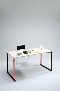a writing desk designed to express the tension and emotional moments of work and stability.