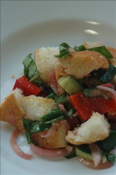 Barefoot Contessa's Panzanella Salad ~ Pan roasting the bread makes this salad really good...the dressing is soaked up by the warm croutons