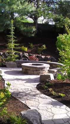 The stone seats give the firepit area a more permanent look. we have a perfect spot in the yard for a firepit! Gonna do it!