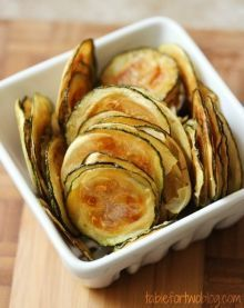 Zucchini Chips - 1 lg. zucchini, 2 Tbsp olive oil, kosher salt.  brush oil on each slice of zucchini.  sprinkle salt onto the cookie sheet of slices.  do not over season.  225 degrees for 2 hours or until they start to brown and aren't soggy.  Let cool before removing.  Keeps for only 3 days in airtight container..