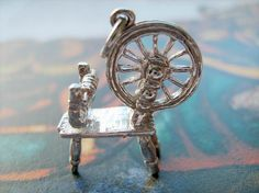 sterling silver spinning wheel charm