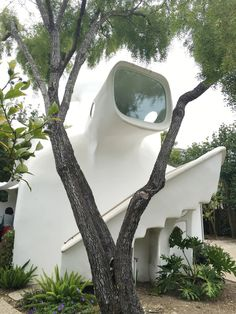 """The """"Spaceship"""" house is owned by designer Angelina Rennell's mother, Cynthia. She helped her mom both restore and decorate the space, and it's 700 square feet of groovy, modern, space age style. \With thick white walls, organic shapes, bohemian textiles and a spaceship-like shape, this California house is out of this world! Take a tour for some ultra modern and minimal inspiration."""