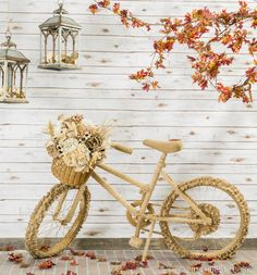 Dress up an old bike with layers of burlap ribbons and flowers for an elegant photography prop or front porch decor.