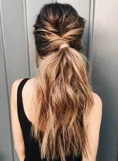 As I have mentioned, a long wavy ponytail can be chic. You can wear it like this - twisted and loose with wavy hair. #wavyhair #hairstyle