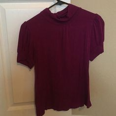Magenta short sleeve turtleneck, keyhole back Soft cute magenta top. Keyhole and button details on the back. 96% rayon, 4% spandex. Size petite small. Great condition. Fever Tops Blouses