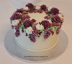 http://www.cakecentral.com/gallery/i/3330857/purple-and-lavender-buttercream-flower-cake