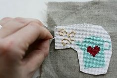 How to cross stitch on fabric while keeping the aida grid. I never would have thought of this! I might wana try it.