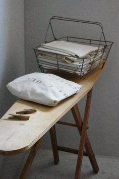 Pour le linge    There is something about a standing ironing board that I think looks wonderful.  It gives the room a cozy, warm feeling, a sort of lived in look...