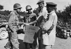 The Americans and the British meet at Randazzo, 13 August 1943. From the left: Col George A. Smith (18th Infantry Regiment, 1st Infantry Division), Col. H. A. Flint, Maj. Gen. Vyvyan Evelegh, and Brig. Gen. E. E. Cass.