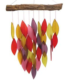 Sandblasted glass pendants lend breezy appeal to this natural wind chime, while a driftwood hanger adds natural charm.
