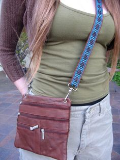 This soft leather purse came with a REALLY crummy strap, so I replaced it with one of my handwoven ones. Annie MacHale   (ASpinnerWeaver on Etsy)