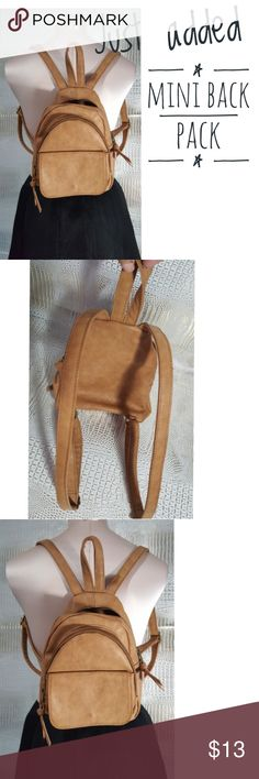Mini vegan leather back pack tan color adjustable Mini vegan leather back pack tan color adjustable straps used one time . Lots of room for a little bag   No visable signs of wear or damage   Pre owned condition *******All items are in pre owned condition, Nothing, unless noted , is brand new **** please ask questionsFor sale in my posh closet  www.poshmark.com/closet/poshmarkmentors  #poshmarkseller #collections #followforfollow #fashionphotography #bloggers #ladiesoffashion #fashionfinds…