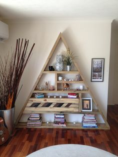 Custom Bermuda triangle bookcase handmade from recycled timber sleepers and pallet timber www.simplyrecycledfurniture.com.au