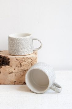 DETAILS Ultra-minimal stoneware mug for your morning coffee or tea.Velvet matte crackle glaze with a crystally white interior.Handmade - each piece may vary slightly. Ceramic Tableware, Stoneware Mugs, Ceramic Mugs, Kitchenware, Pottery Mugs, Ceramic Pottery, Pottery Ideas, Slab Ceramics, Ceramics Ideas