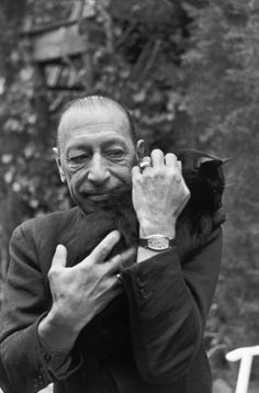 Igor Stravinsky (composer, pianist and conductor) with his cat • photographed by Henri Cartier-Bresson