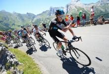 Chris Froome discards his water bottle on the climb of the Col d'Aubisque in the heart of the Pyrenees, ahead of Mark Cavendish and Levi Leipheimer