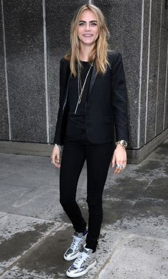 Cara Delevingne in silver high top trainers out in London