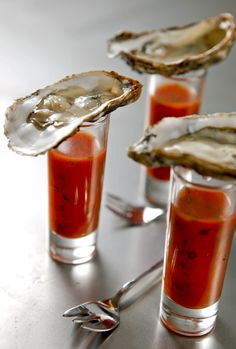 vodka oyster shots Dash of red Tabasco Dash of green Tabasco Dash of cocktail sauce Worcestershire sauce Dash of horseradish 1 ounce vodka 1 fresh, cold oyster Wedge of lemon More