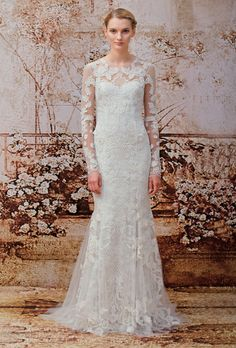 Brides.com: Monique Lhuillier - Fall 2014. Lace and tulle subtle mermaid wedding dress with lace illusion neckline and long sleeves, Monique Lhuillier