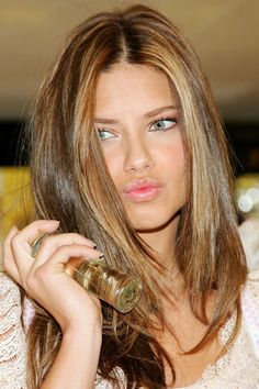 Adriana Lima. Love this hair color.