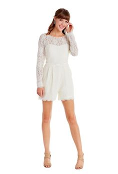 Encore by Watters 'Prato Jumpsuit.' The Prato is a fashion-forward ivory lace, short romper features a bateau illusion neckline and long sleeves. This adorable style has pockets, cotton grosgrain ribbon at waist, and bow detail on back. The Prato is a fashion-forward ivory lace, short romper features a bateau illusion neckline and long sleeves. This adorable style has pockets, cotton grosgrain ribbon at waist, and bow detail on back.