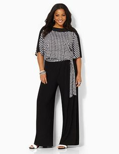 Update your wardrobe with our sophisticated and stylish jumpsuit in a mix of solid colors and houndstooth patterns. Graceful fabric drapes at the tied, stretch waistband for a tummy-concealing silhouette. Wide-leg pants cascade below to finish off your flattering look. Dolman sleeves. Keyhole button opening on upper back. Catherines plus size jumpsuits are expertly designed to flatter your figure. catherines.com
