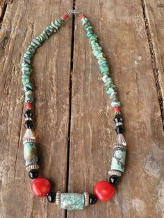 Arizona Turquois chip gemstones with red clay beads, silver fluted & crystal rondells, African Turquois tube beads, antique black round beads, genuine red coral with vintage 1940's conical shaped crystal beads.