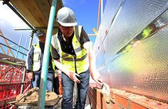 David Cameron on a building site in Lancashire (© Lynne Cameron, PA Wire)