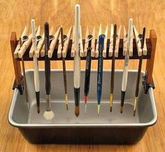 Use clothespins to hold paintbrushes as they dry