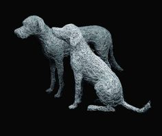 14. Wire dogs on black in the wire studio