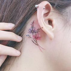 Small Floral Tattoo Behind the Ear