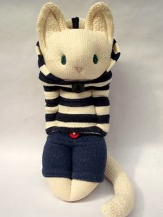 A sailor boy. Little Sockamajig Cat in striped hoodie and navy trousers.
