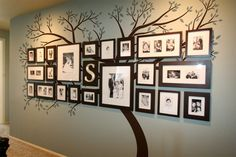 I Love this idea - it would be so easy to paint the tree and then mount the various photos. Love, Love, Love