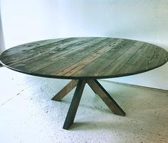 Round Wood Dining Table made from Reclaimed and locally harvested wood>> I'd love to have a short table like this and surround it with floor pillows